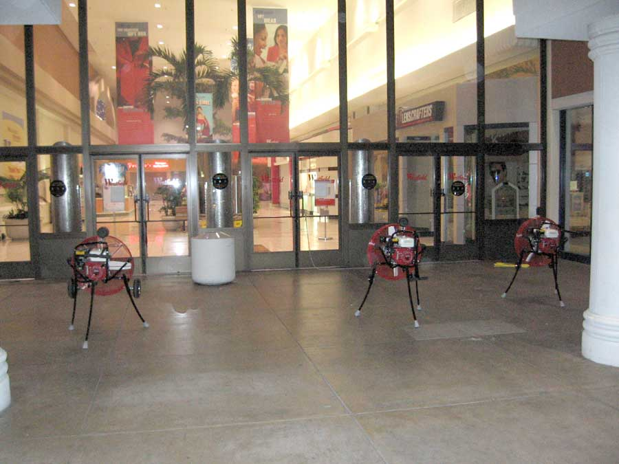 3 portable fans at one entrance cleared millions of cubic feet of smoke while 3 others at another entrance kept smoke from reaching other areas of the mall.